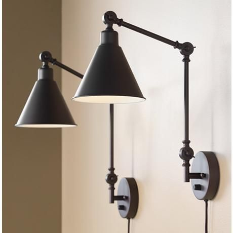 Placed in a bedroom or living room these adjustable swing arm wall lamp set can