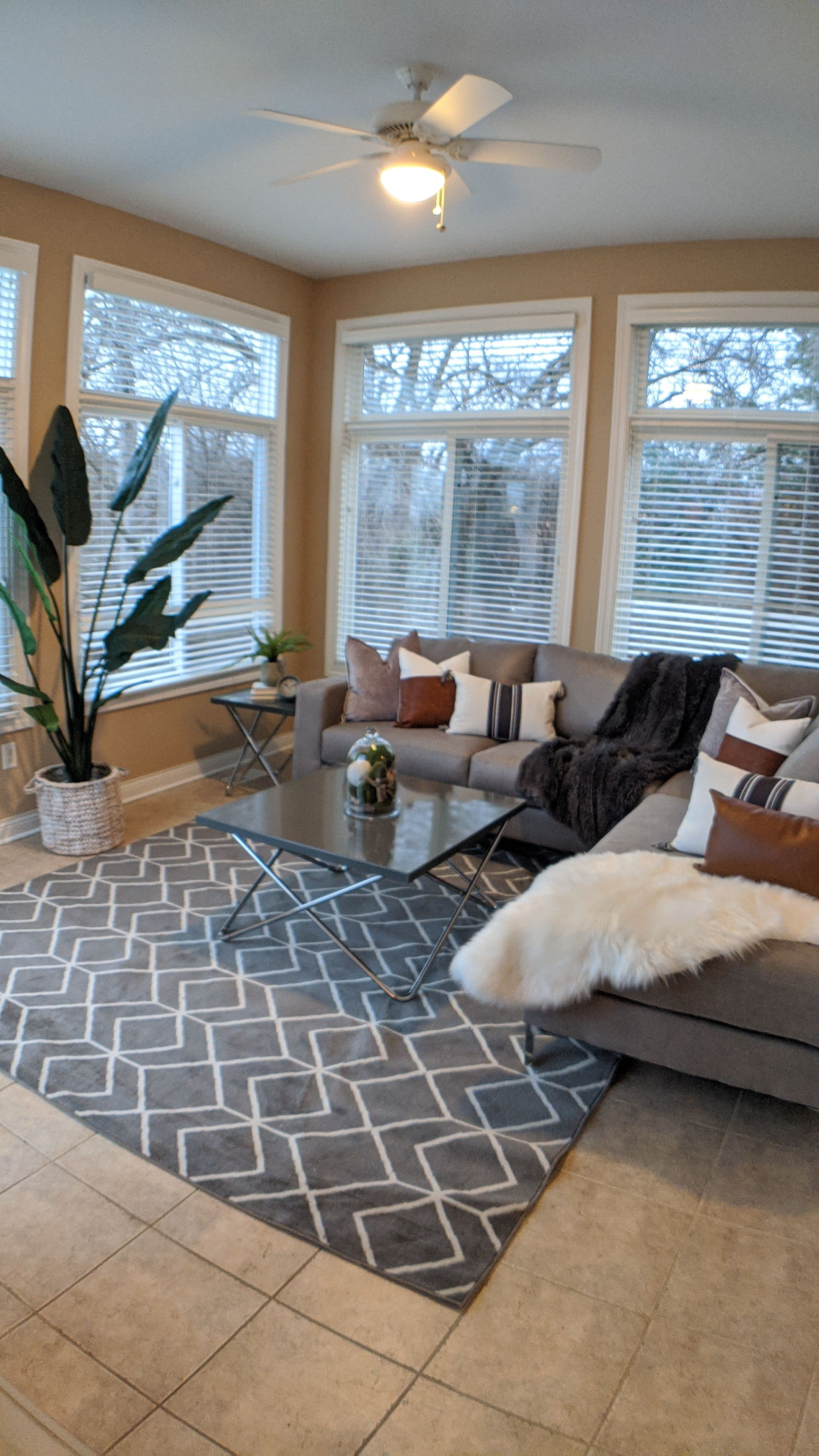 Executive townhome living room navy and gray. Ashley furniture Home staging interior design Velvet couch