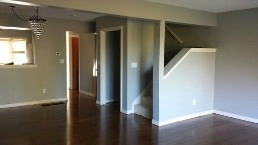 "On the walls: Sherwin Williams ""Gray Clouds"" and ""Origami White"". Minwax ""Provincial"" on the white oak hardwood floors - finished onsite. #paintcolors #graywalls #whitetrim"