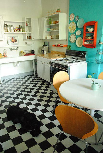 Love the white table, floor, open shelving