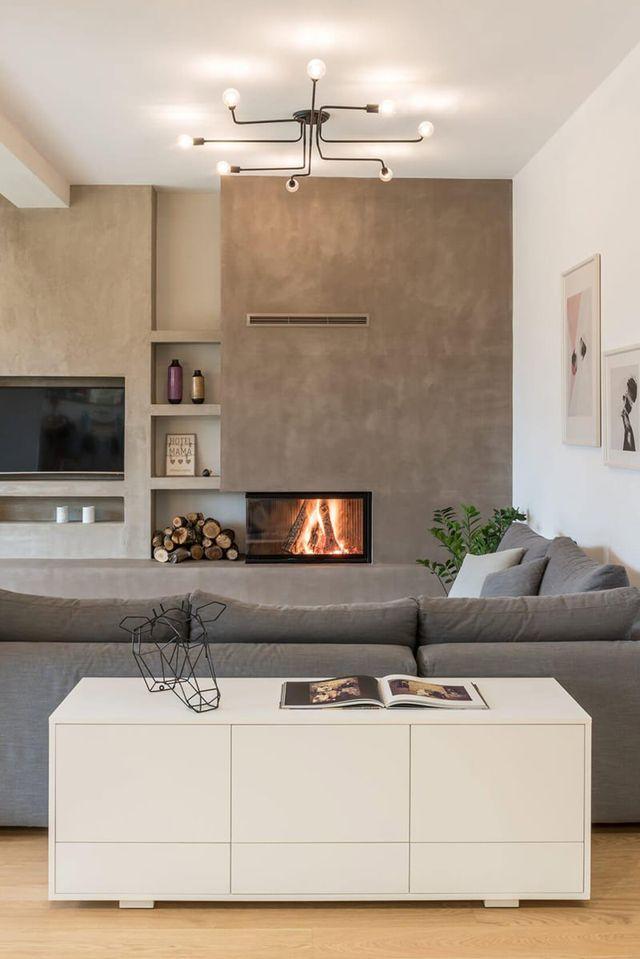 Apartamento pequeno com paredes de cimento queimado e decoração