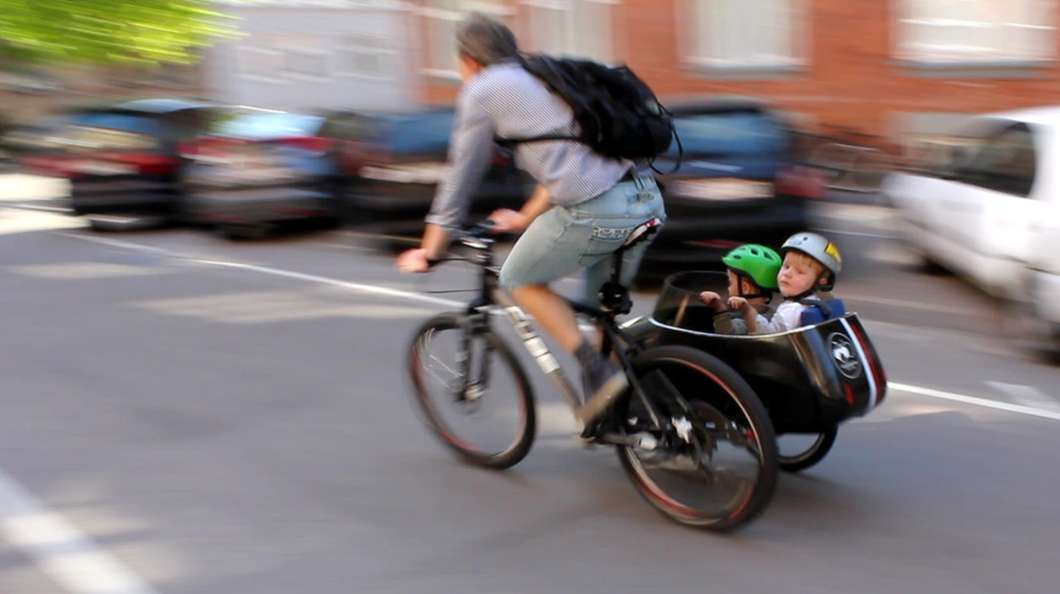 Scandinavian Sidecar Carries Cargo And Children Over Road And Snow