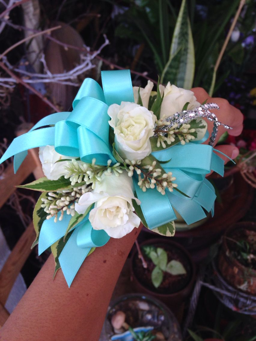 Light Blue Ribbon And White Roses With Silver Details