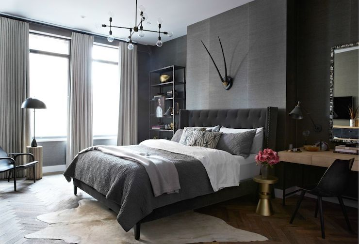 Masculine bedroom features walls clad in dark grey grasscloth ...