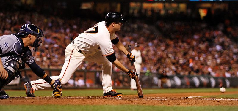San Francisco Giants' Tim Hudson (17) makes a sacrifice bunt against the San Diego Padres in the seventh inning of their MLB game at AT&T Park in San Francisco, Calif., on Thursday, April 30, 2014. (Ray Chavez/Bay Area News Group)