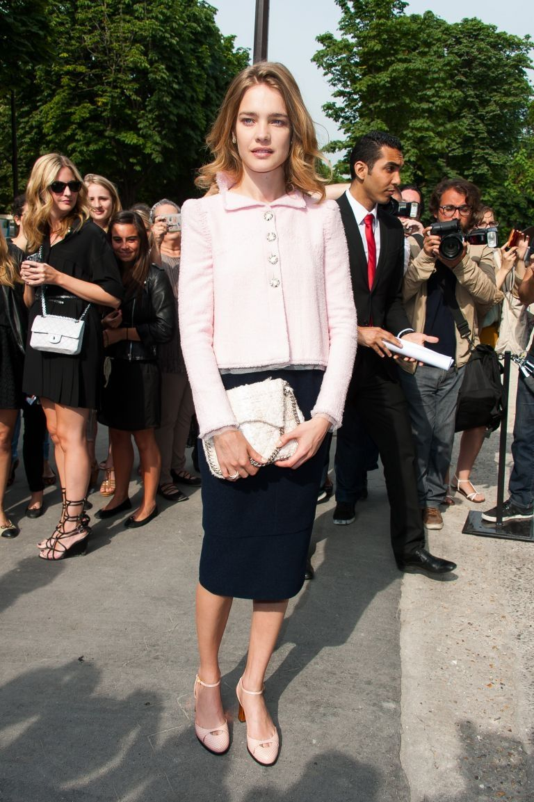 Mid length skirt. Natalia Vodianova Natalia Vodianova gives off a sweet and innocent vibe with her powder pink jacket and matching clutch purse and round-toed sandals. The actress and supermodel has offset the sugary pastel tone with a mid-length black pencil skirt adding a touch of grown-up sophistication. (July 2, 2013)