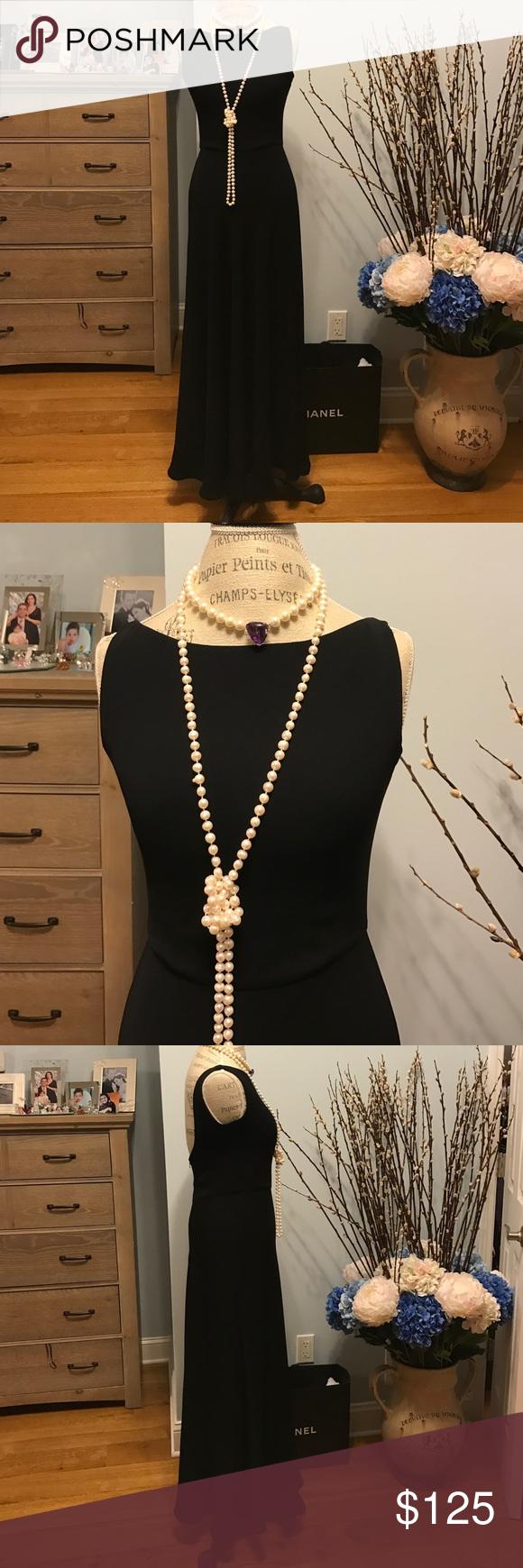 STUNNING GALA BLACK DRESS RALPH LAUREN STUNNING GALA BLACK DRESS. Long black invisible zipper. Very deep exposed back. Long flowy skirt. Never worn. Ralph Lauren Dresses Wedding