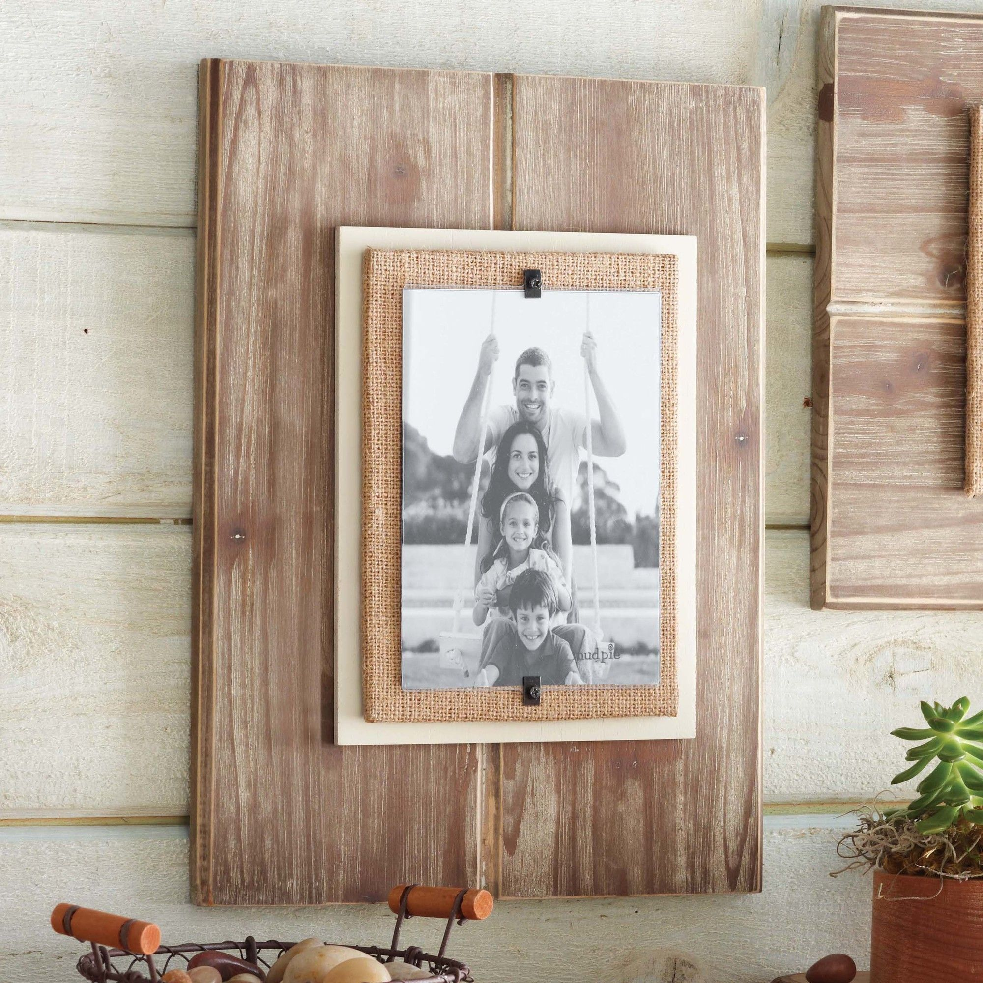 Features distressed wood frame with burlap and painted for Bungalow style picture frames