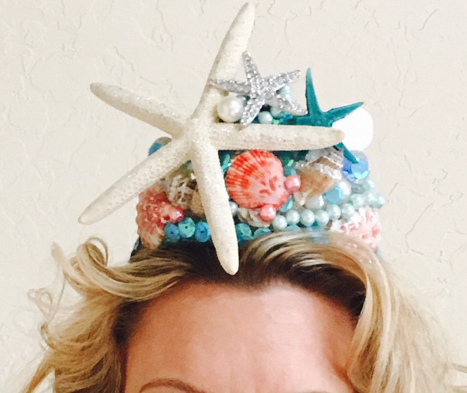 A personal favorite from my Etsy shop https://www.etsy.com/listing/280569152/mermaid-shell-crown