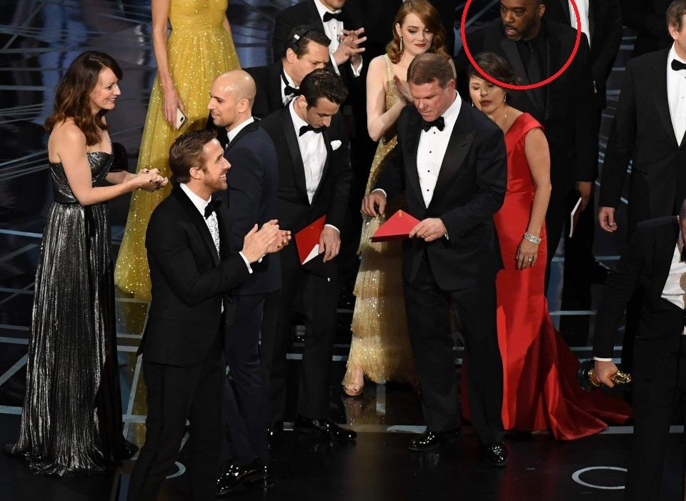 Incredulous reaction of the one black guy in La La Land as everybody else tries to keep their composure
