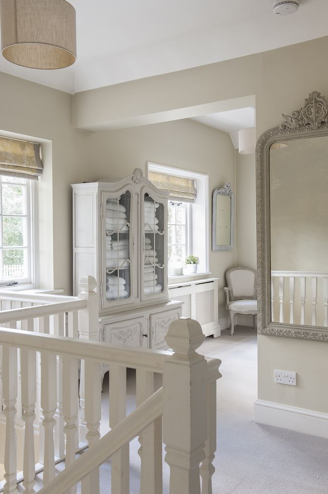 French-style touches include this French armoire on the upstairs ...