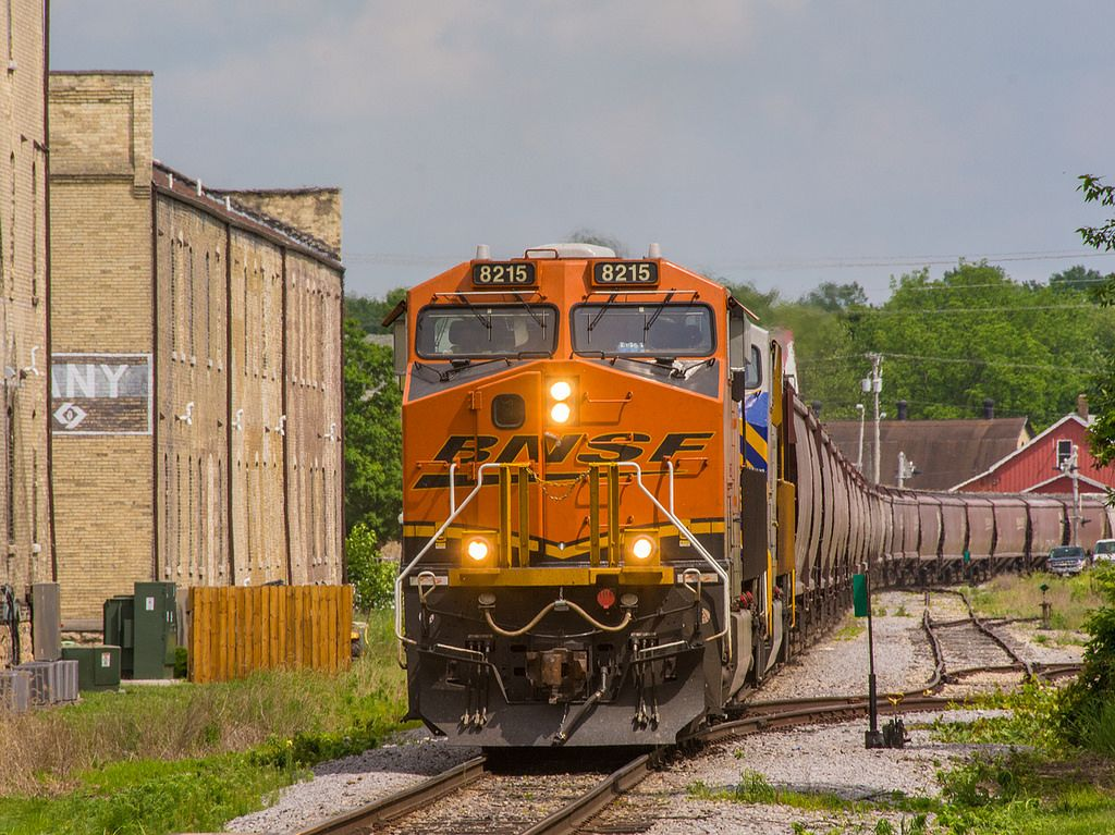 https://flic.kr/p/tczKqU | 060415 BNSF 8215_4 | 3rd loaded grain train out of Avalon WI on the WSOR bound for BNSF interchange at Crawford WI cuts downtown Edgerton in half.   06/04/15