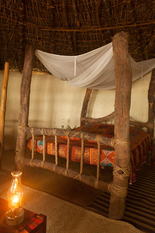 Mudhut @ Selous River Camp | Mudhuts | River camp, Curtains