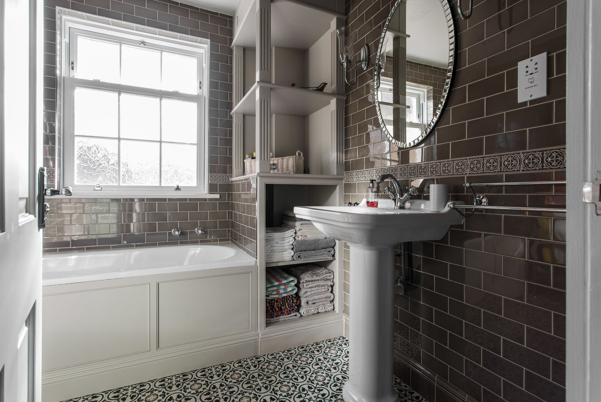 A contemporary family bathroom with traditional style and ...