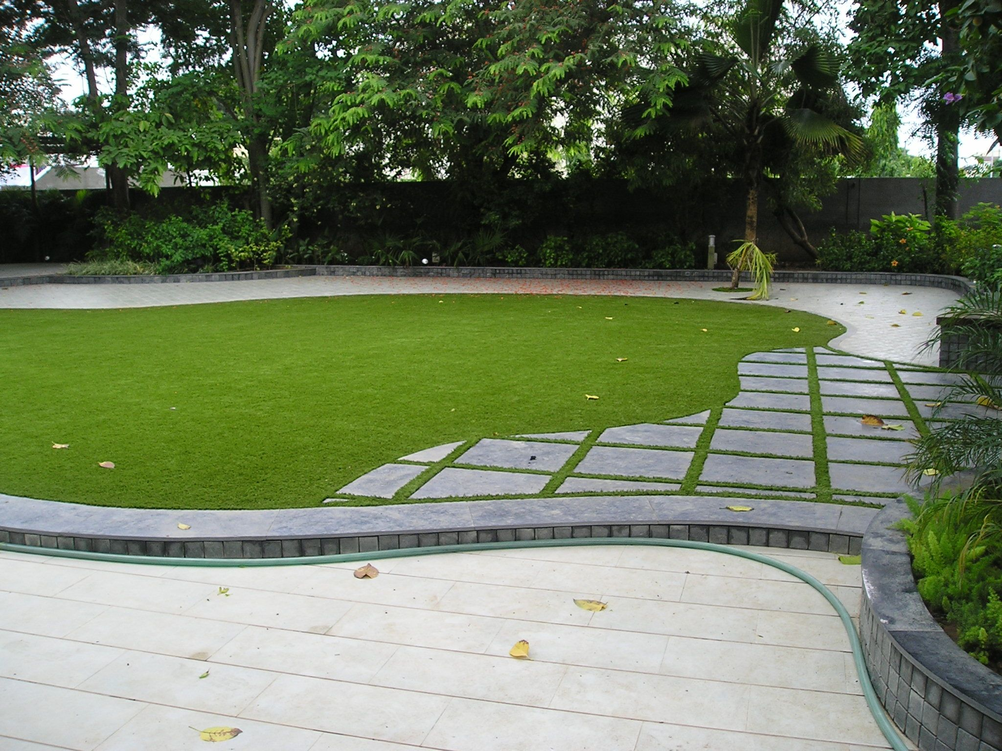 it has been rightly said a garden a bungalow makes a perfect pair the contemporary garden design by lush green makes this installation a beautiful