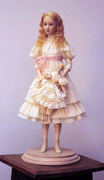 Glasha - In Silk crushed chiffon and traditional French laces. Footwear is made of natural suede. Wig is real mohair. The small doll is made of porcelain wearing a French lace and natural silk dress.