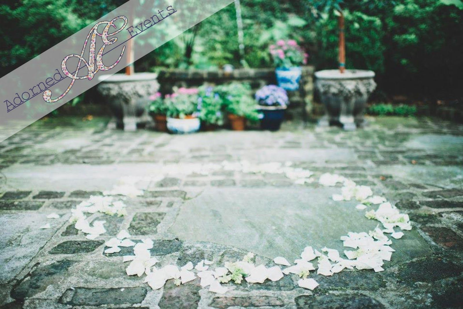 A ring of petals in place of an arch at this garden wedding  http://www.adornedbyadorn.blogspot.com/  Photography by Tim Will Photography