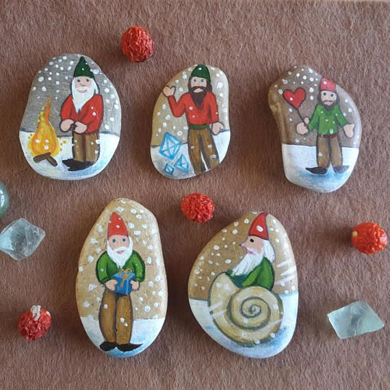 Christmas gnomes hand painted on pebbles Christmas gnomes home decor on Etsy by Claudia Nanni Fine Art #Waldorf #gnomes #homedecor #Christmas #etsy