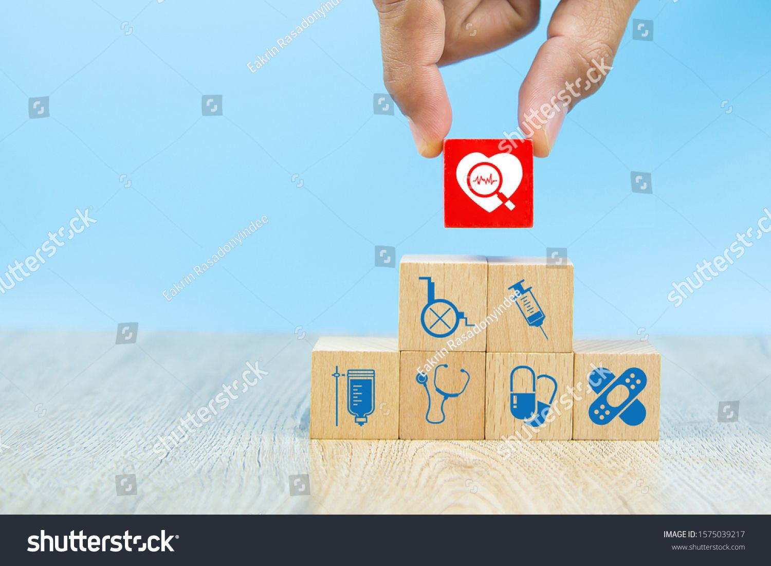 Health care and medical symbols on wooden blocks for health insurance concepts
