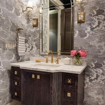Elegant Powder Room Showcases A Gorgeous Arch Vanity Mirror Flanked By E
