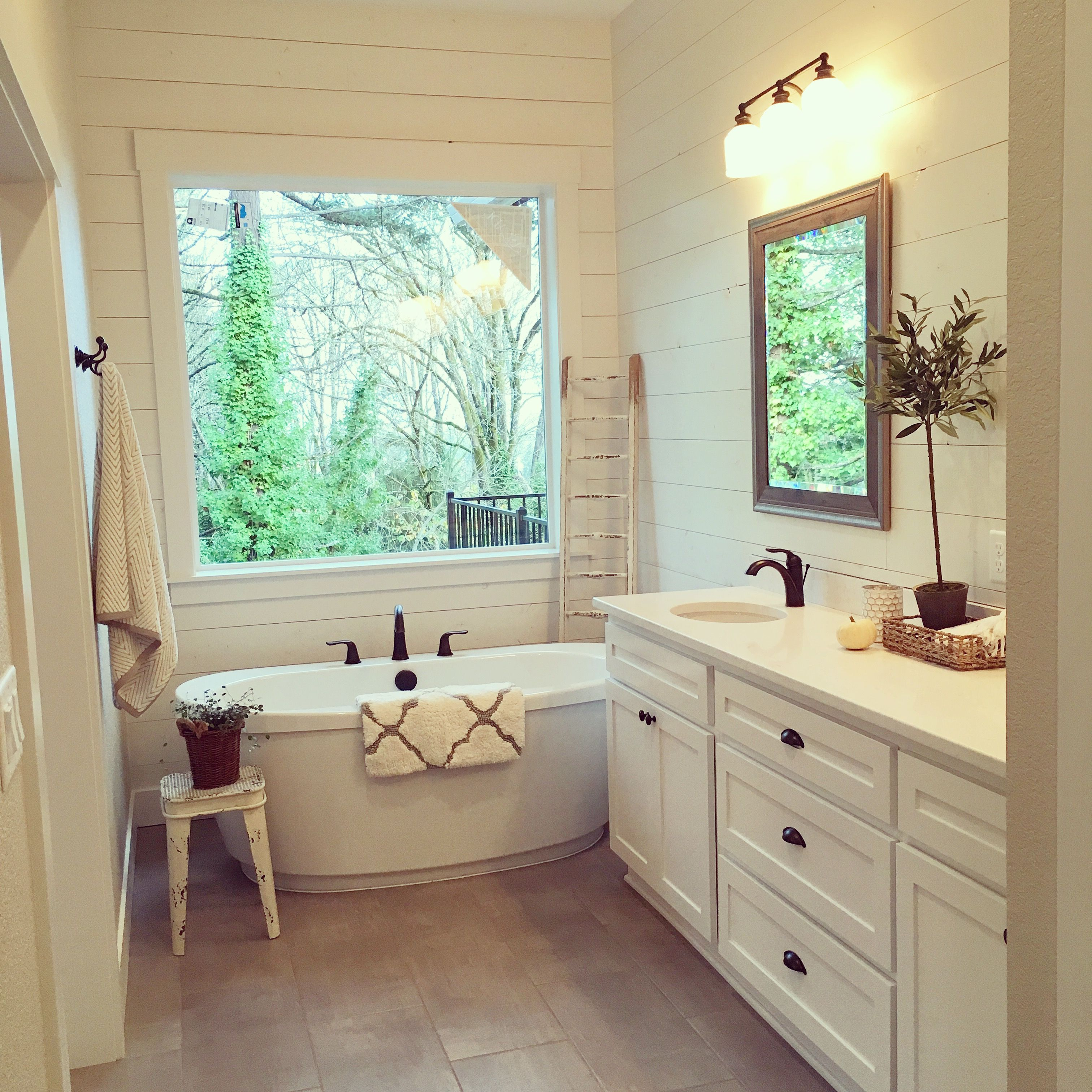This master bath. The shiplap, freestanding tub, and ...