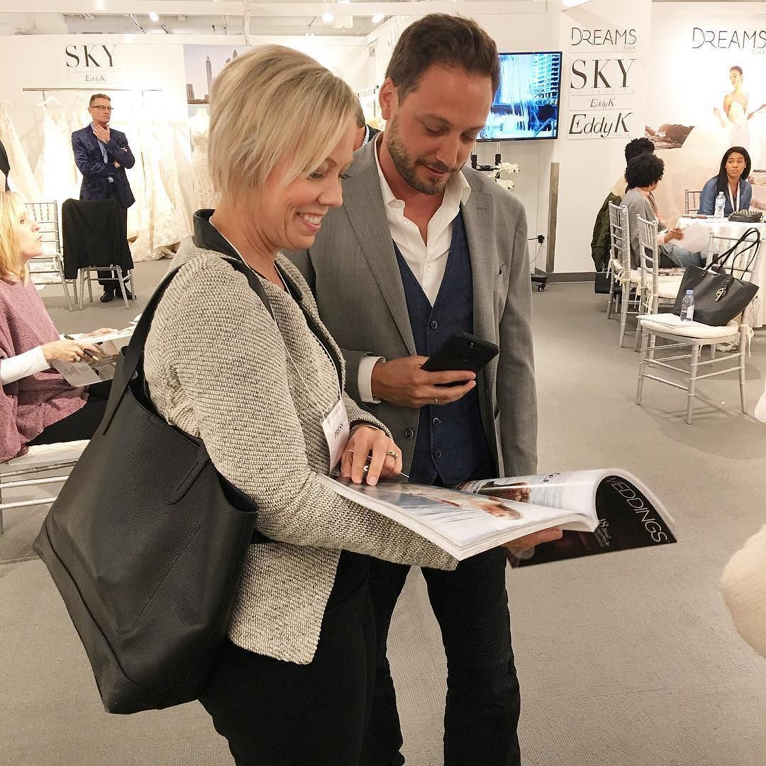 Showing Eddy from @eddyk_bridal his dress from our latest issue at the Chicago Bridal Show
