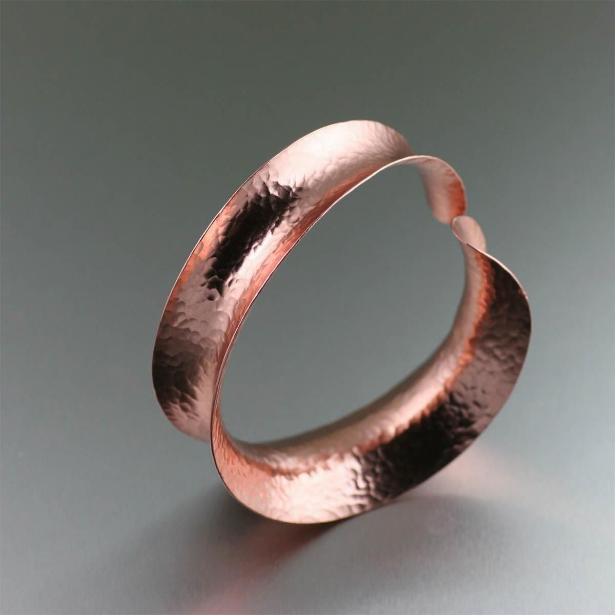 New! Hammered Copper Bangle Shown by https://www.ilovecopperjewelry.com/anticlastic-hammered-copper-bangle-bracelet.html #7thAnniversary #Jewelry