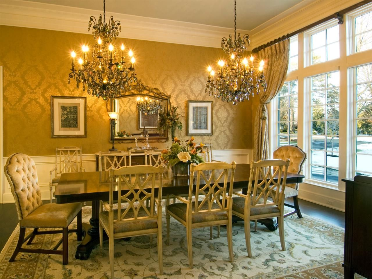 Elegant Yellow Gold Victorian Dining Room Featuring Double Chandeliers