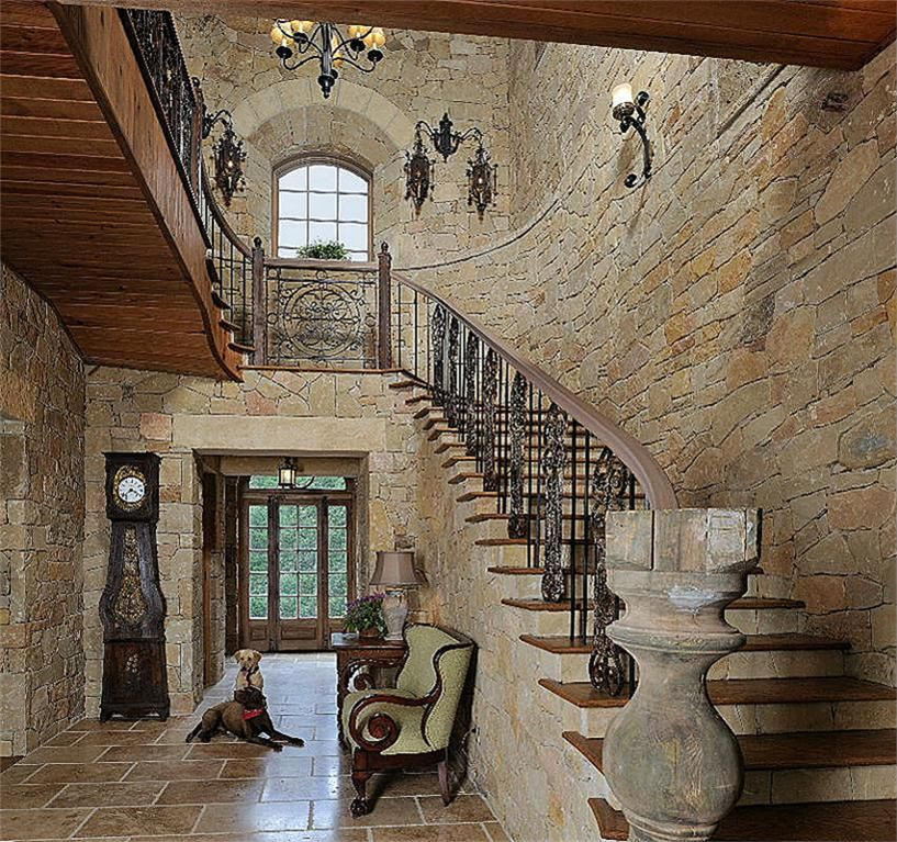 Stone walled foyer in texas hill country style home for Stone house interior