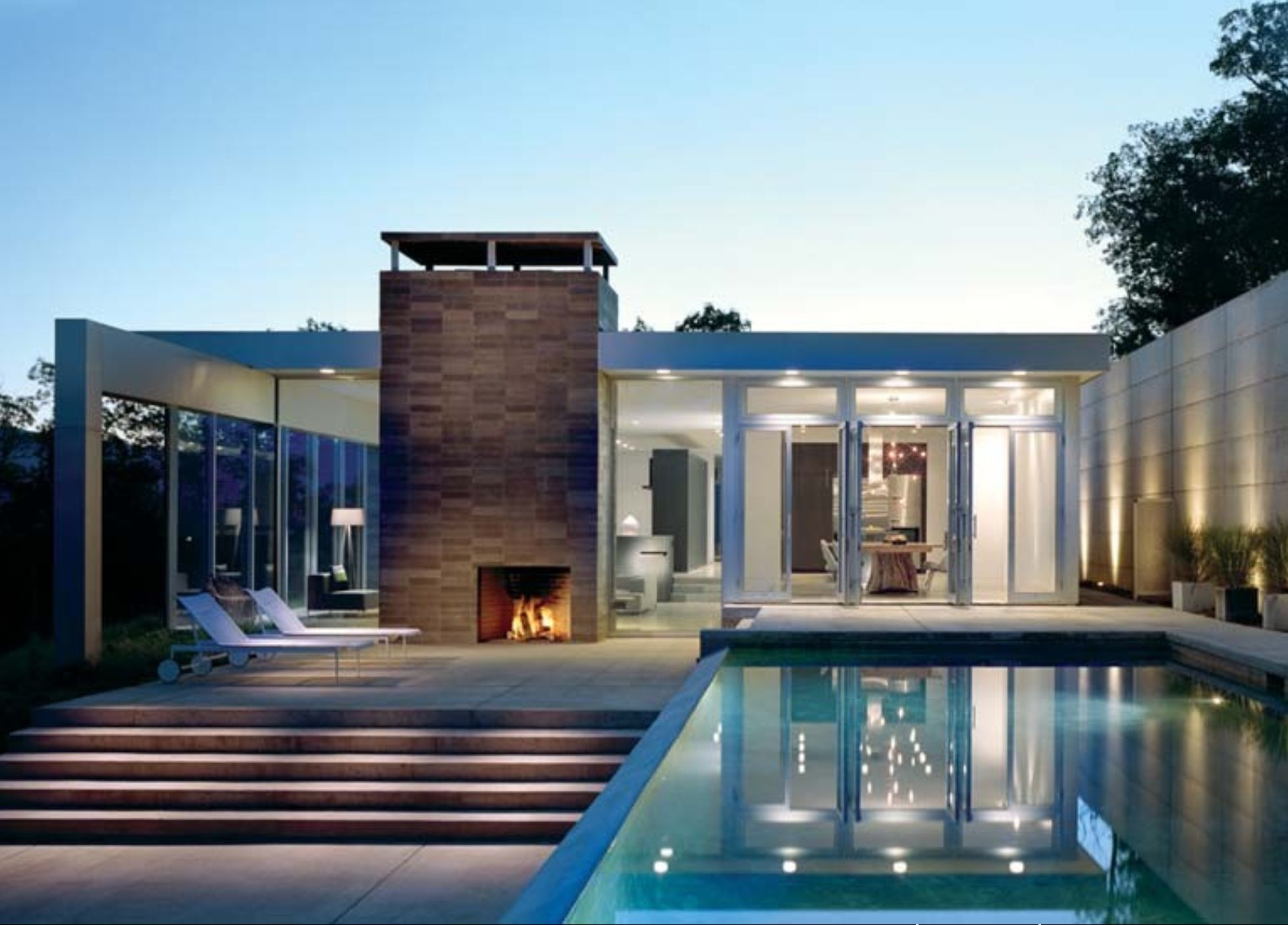 Modern Fireplace, Lots Of Windows, Raised Pool, & Sleek Steps