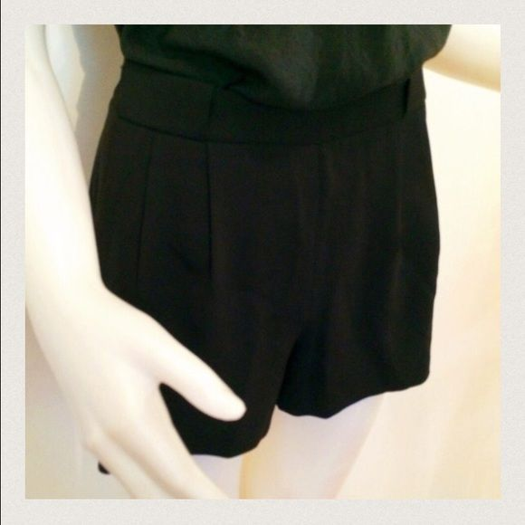 BCBG MaxAzria Shorts BCBG MaxAzria Black Pleated Shorts. Cute shorts for a night out. Looks great with sheer or opaque tights worn underneath. Shorts have pleating in the front and two deep pockets on the side. Looks very chic with a cute top tucked in. So sad to let it go! They no longer fit. Only worn once and dry cleaned. BCBGMaxAzria Shorts
