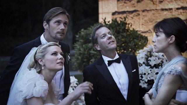 Still of Kirsten Dunst, Kiefer Sutherland, Charlotte Gainsbourg and Alexander Skarsgård in Melancholia