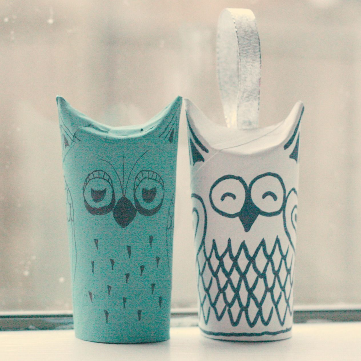 DIY Owl out of toilet paper tube! You can also glue a ribbon under the fold to make a cute Christmas ornament. <3