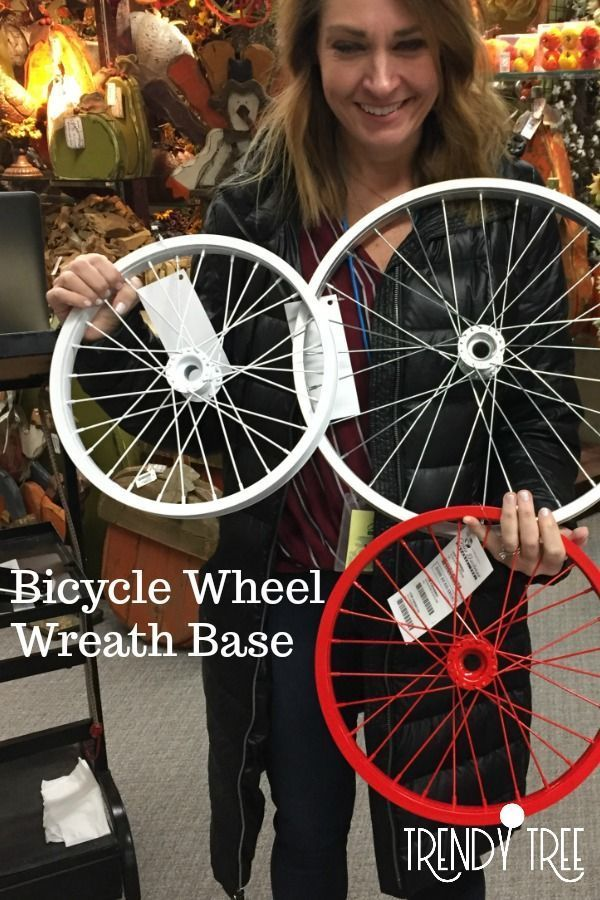 The bicycle wheel used as a wreath base, covered in flowers makes a very unique door decoration. Several colors coming soon to Trendy Tree. Check out our wreath making supplies and more at TrendyTree.com