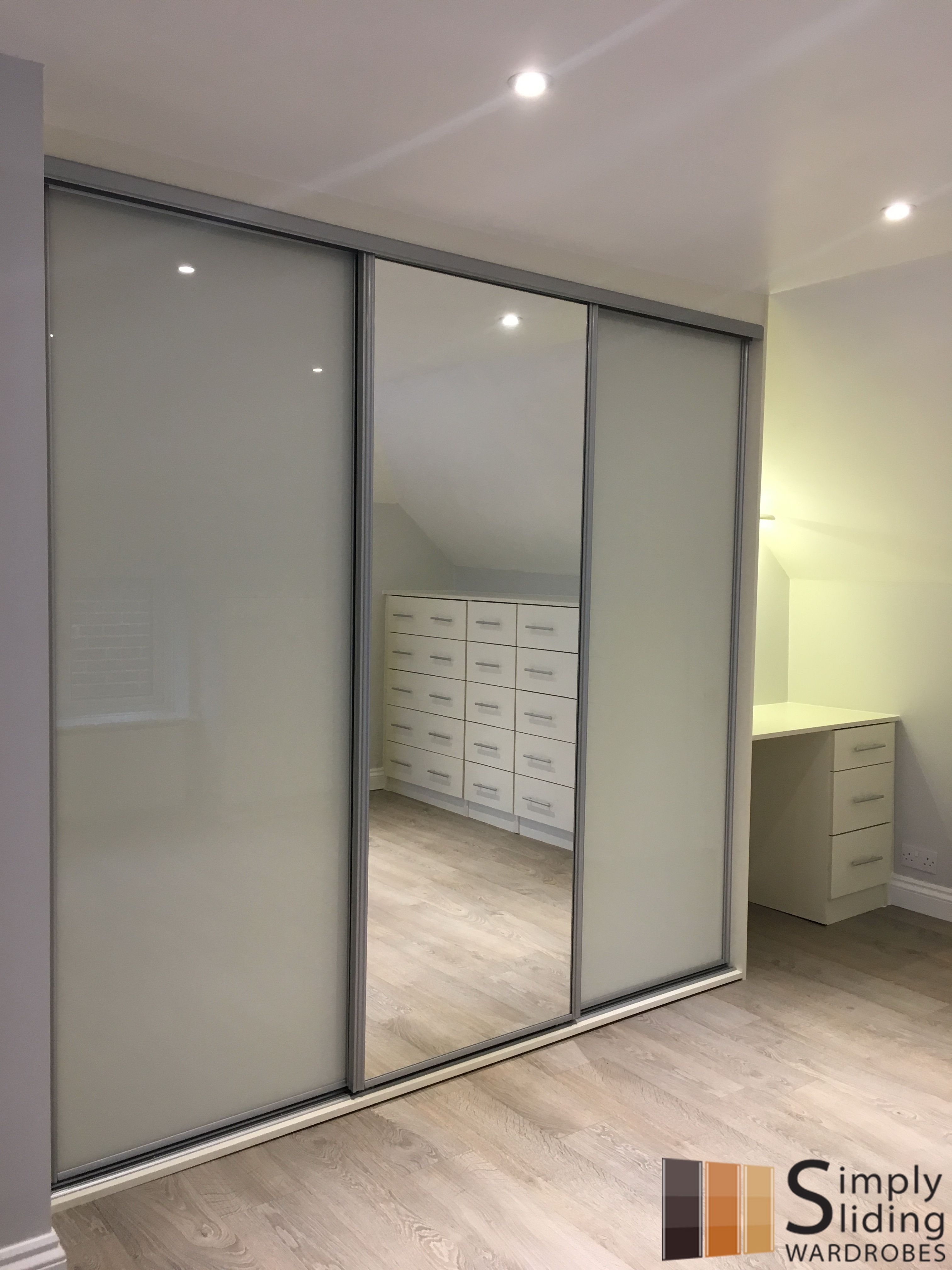 One Of Our Multi Panel Grey Glass Sliding Door Wardrobes Wardrobe Door Designs Wardrobe Doors Sliding Door Wardrobe Designs
