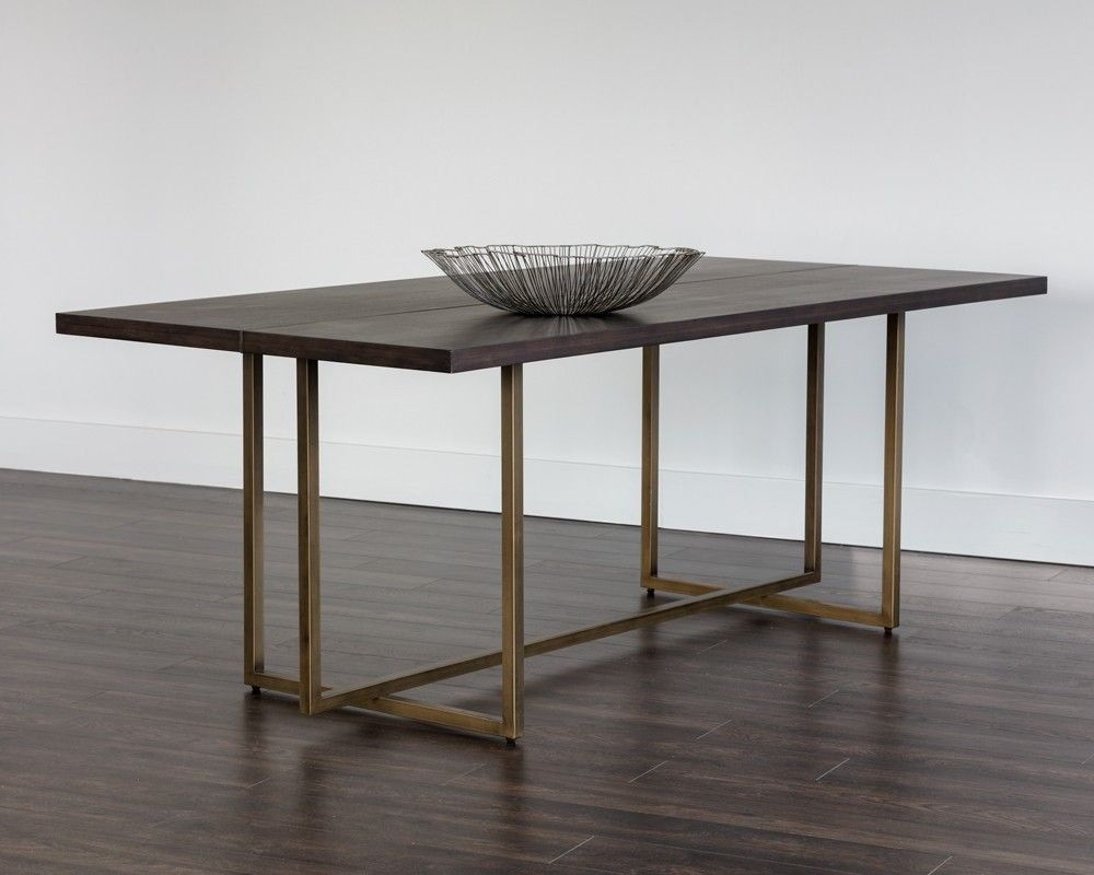 Jade dining table features a stunning acacia wood veneer tabletop with antique brass steel detailing down the centre and matching base