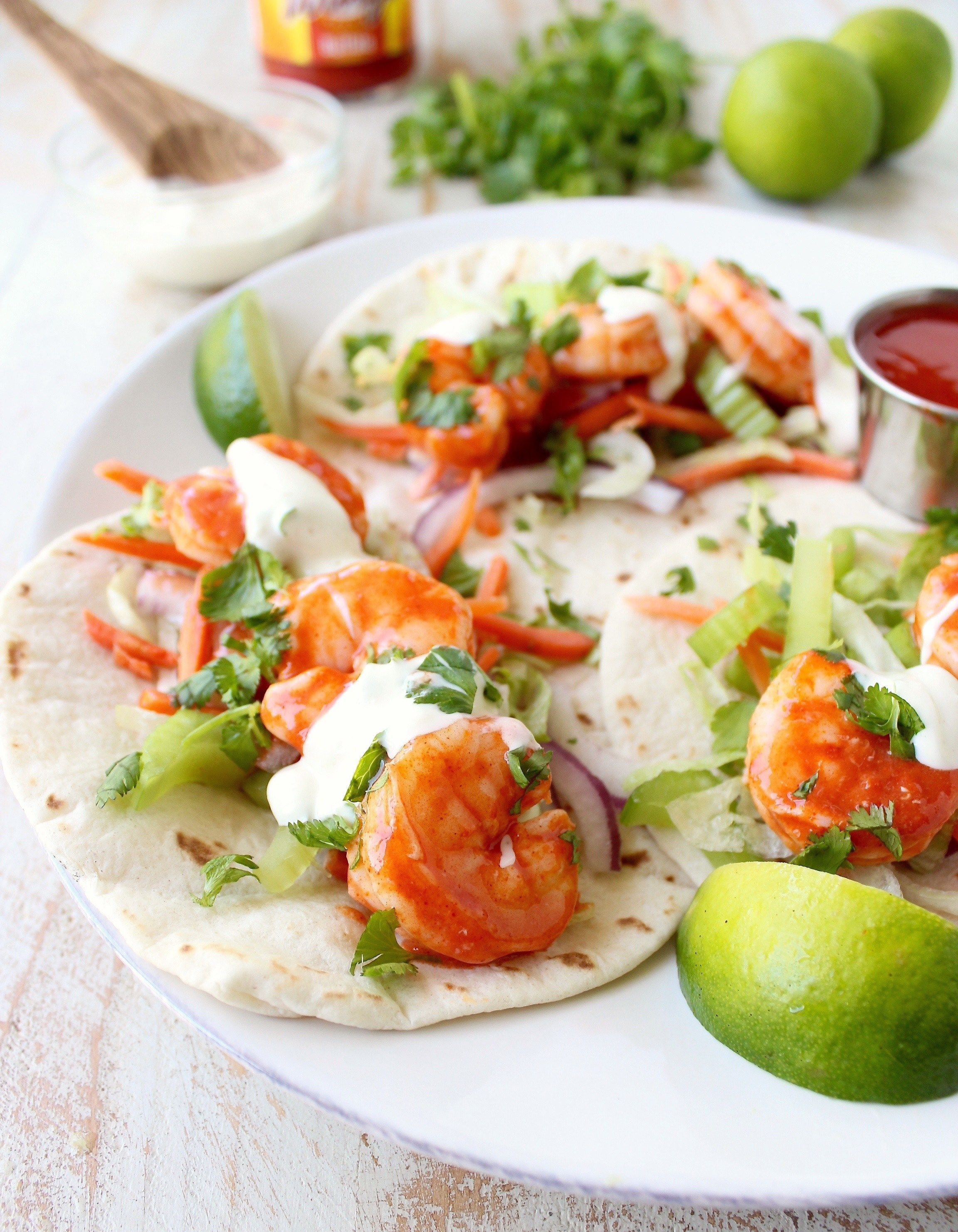 Buffalo Shrimp Tacos are an easy weeknight meal, made in just 15 minutes! They're also perfect for celebrating Taco Tuesday or Cinco De Mayo! #buffaloshrimp Buffalo Shrimp Tacos are an easy weeknight meal, made in just 15 minutes! They're also perfect for celebrating Taco Tuesday or Cinco De Mayo! #buffaloshrimp