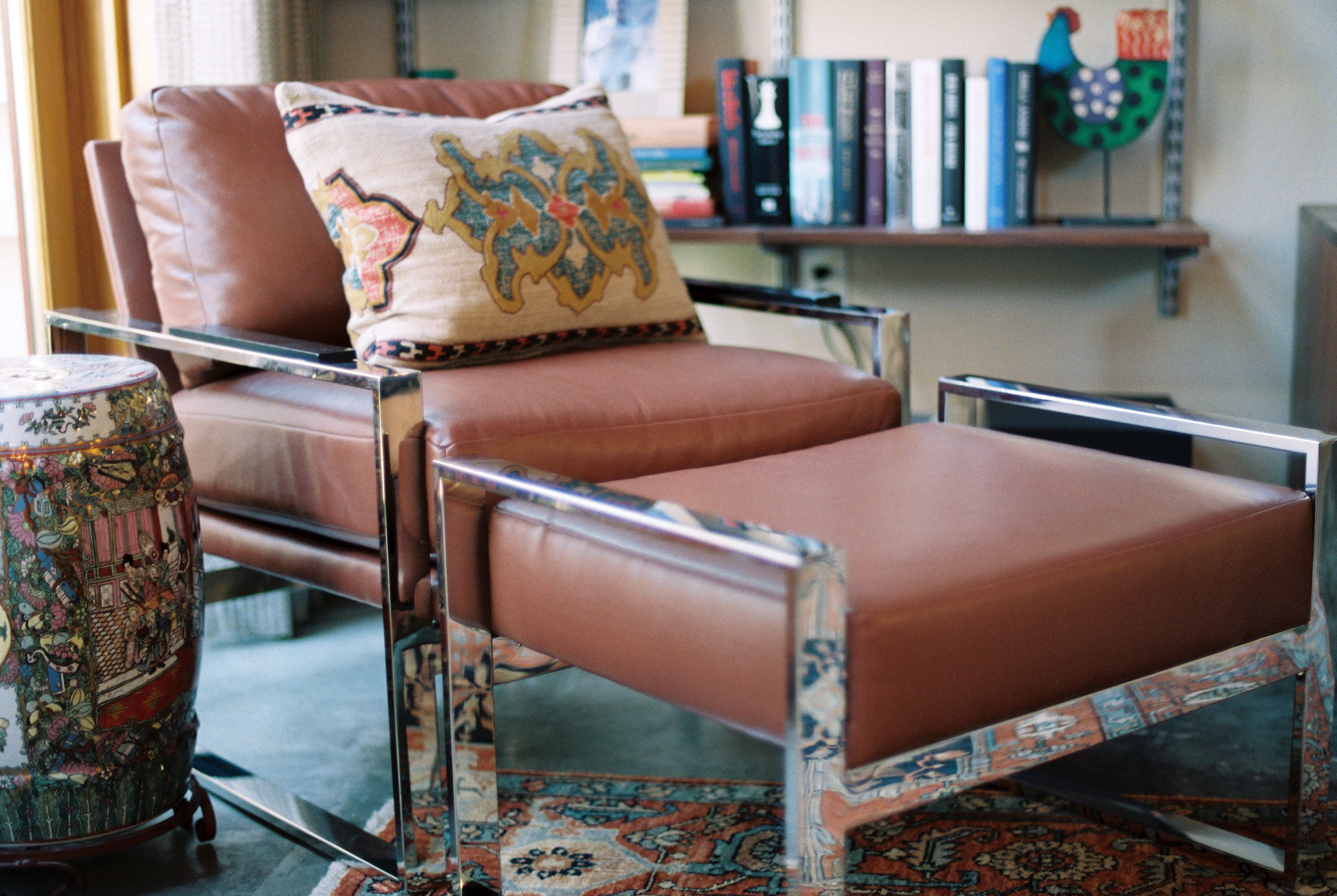 A Modern Leather Chair With A Polished Chrome Finish Adds Some Bling To The  Space To