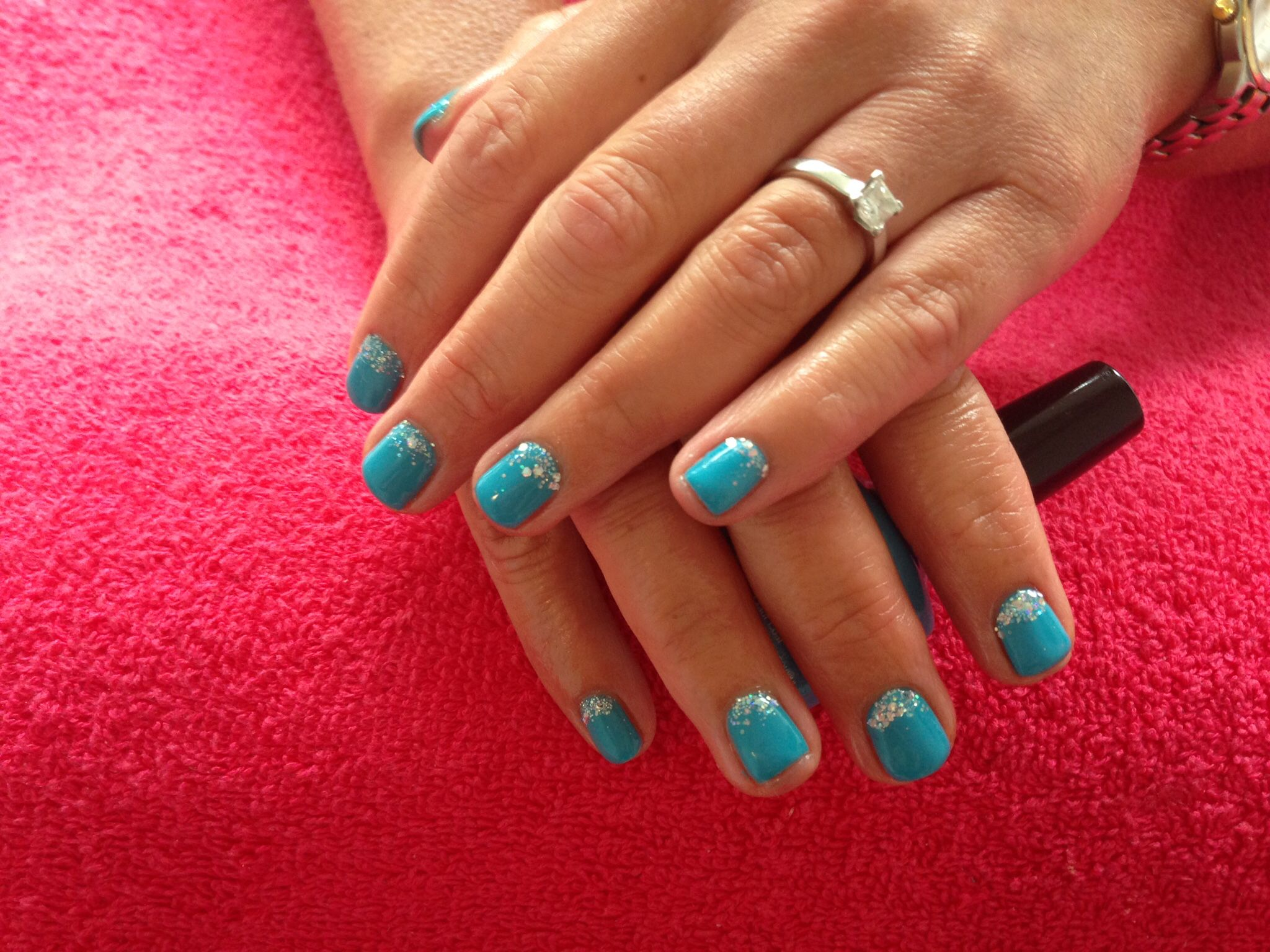 My own nails done with a gorgeous torquiose blue shellac & silver glitter