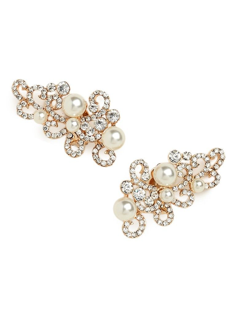 Talk about extreme elegance. These stunning statement earrings flaunt a graceful curlicue silhouette, which comes gorgeously covered in crystals and bold pearls.