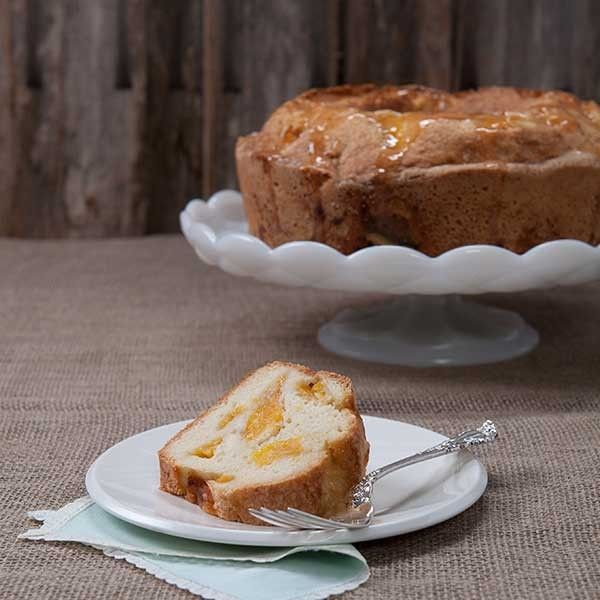 Georgia Peach Pound Cake #peachcobblerpoundcake Are you missing your peaches and ice cream? Maybe some homemade peach cobbler?  Well guess what - you can now get our Peach Cake from Mary's Kitchen year-round! #peachcobblerpoundcake