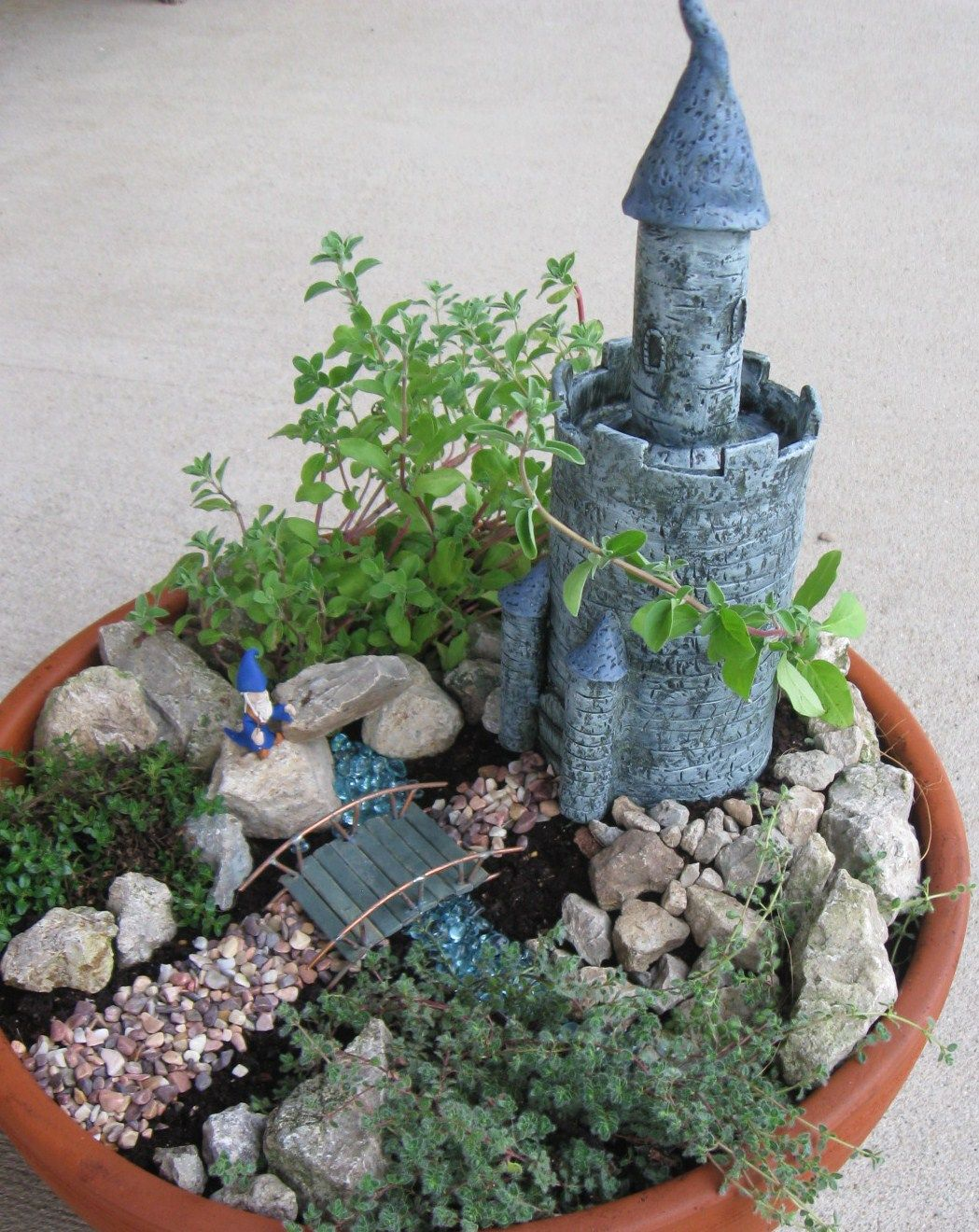 'Mini Herb Fairy Gardens' - how to make your own (an interesting post!) This one with a castle is called 'Wizard's Keep.'