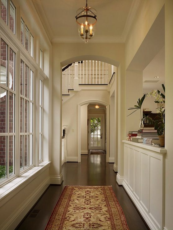 Blue Foyer And Hallway : Corridor leading to foyer features glass lantern