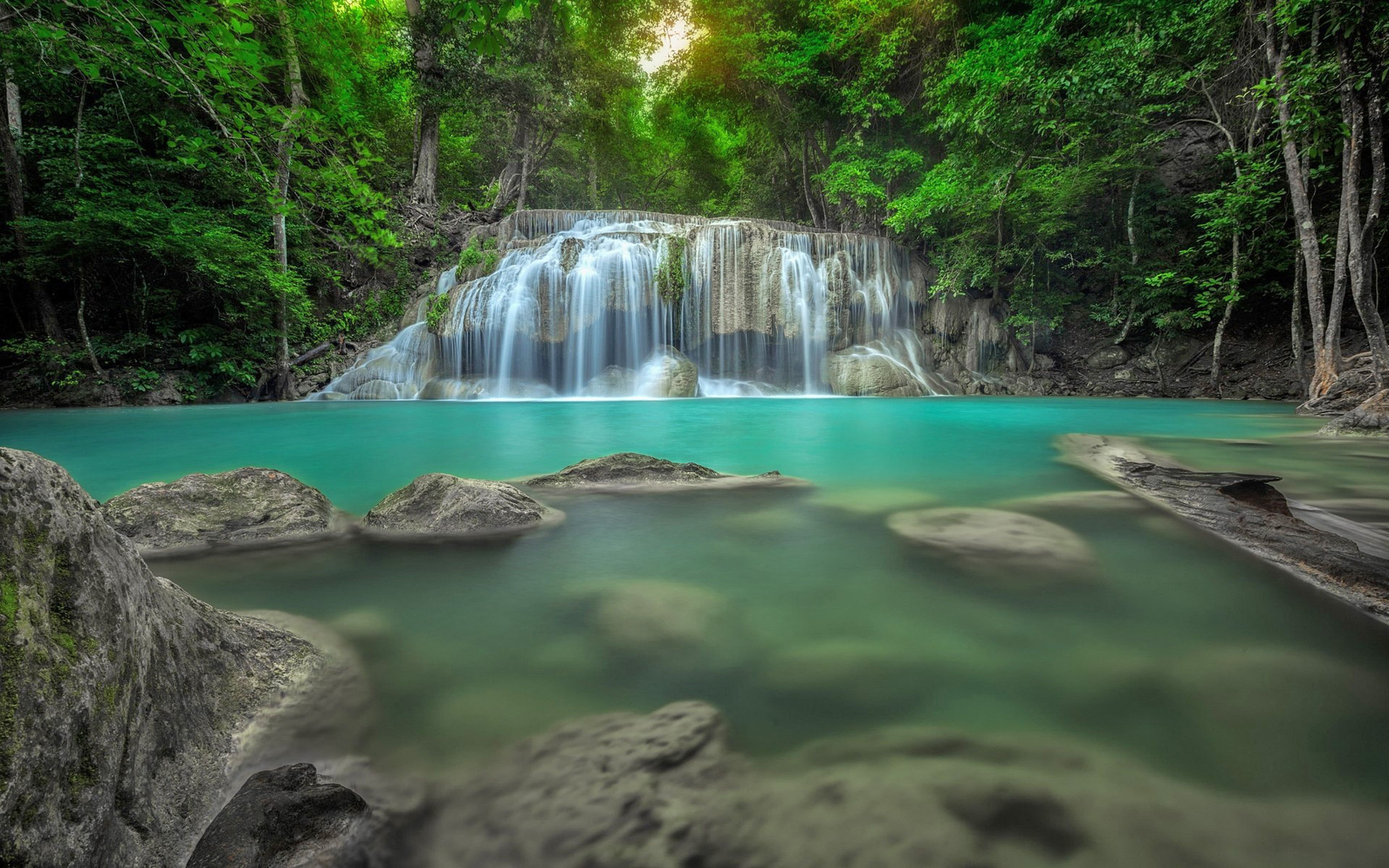 Erawan Waterfall In Thailand Jungle Rain Forest Rocks In Water