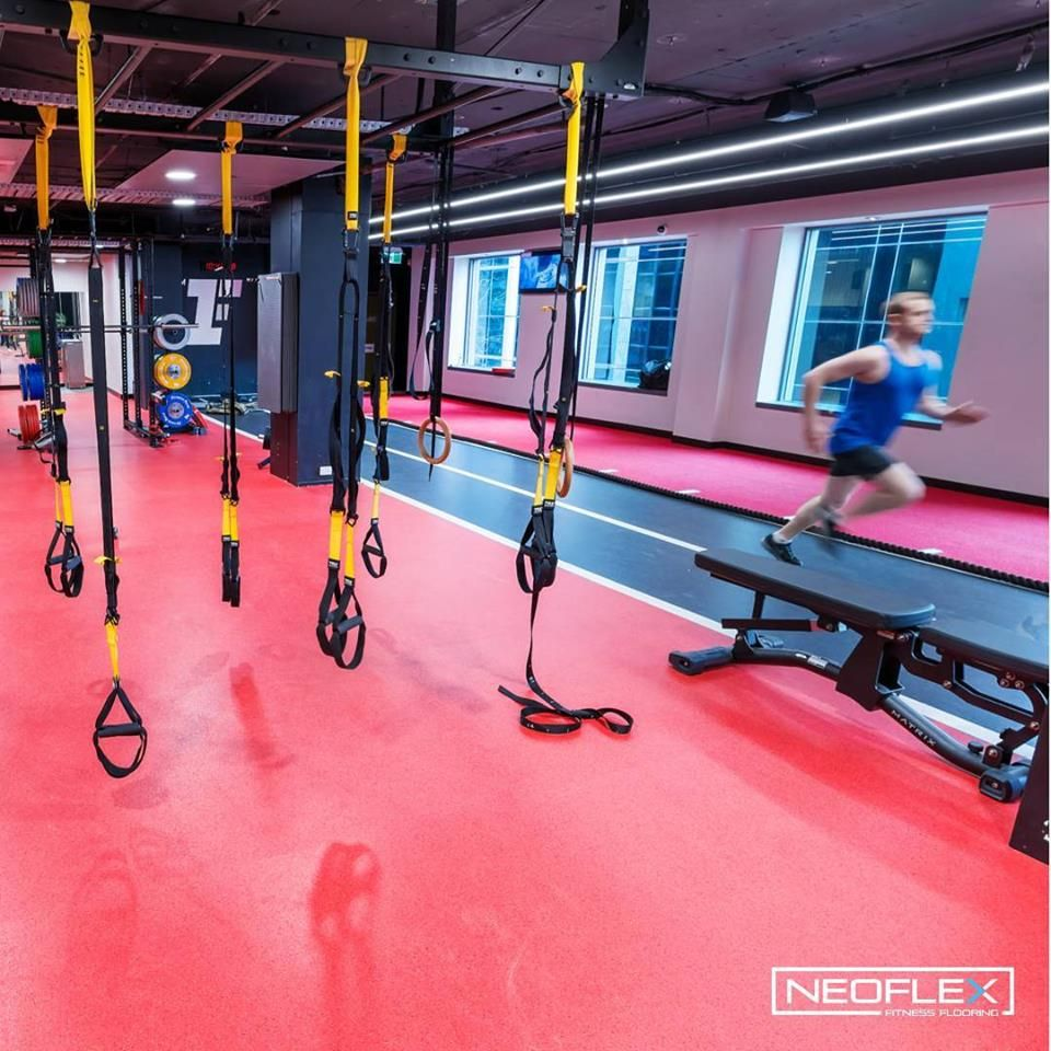 Bright red neoflex fitness flooring at fitness first