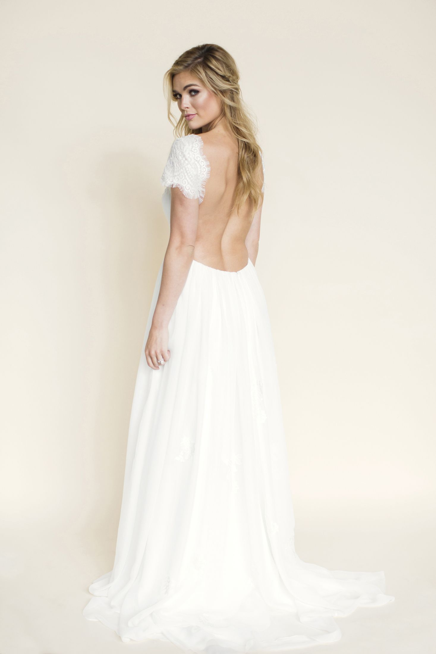Lace wedding dress with cap sleeves sweetheart neckline  Sunny Darling  This freespirited dress features a modified vneck