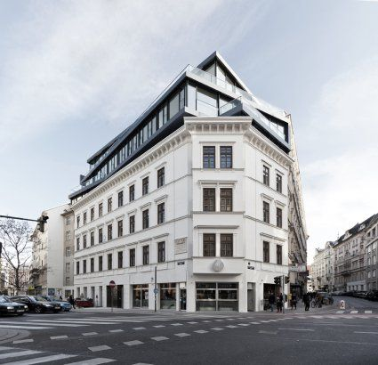 modern three story rooftop extension added to existing Wilhelminian-times house in Vienna