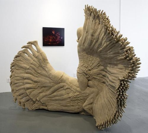 Sand sculpture by artist Katie Grinnan captures timelapse of yoga pose