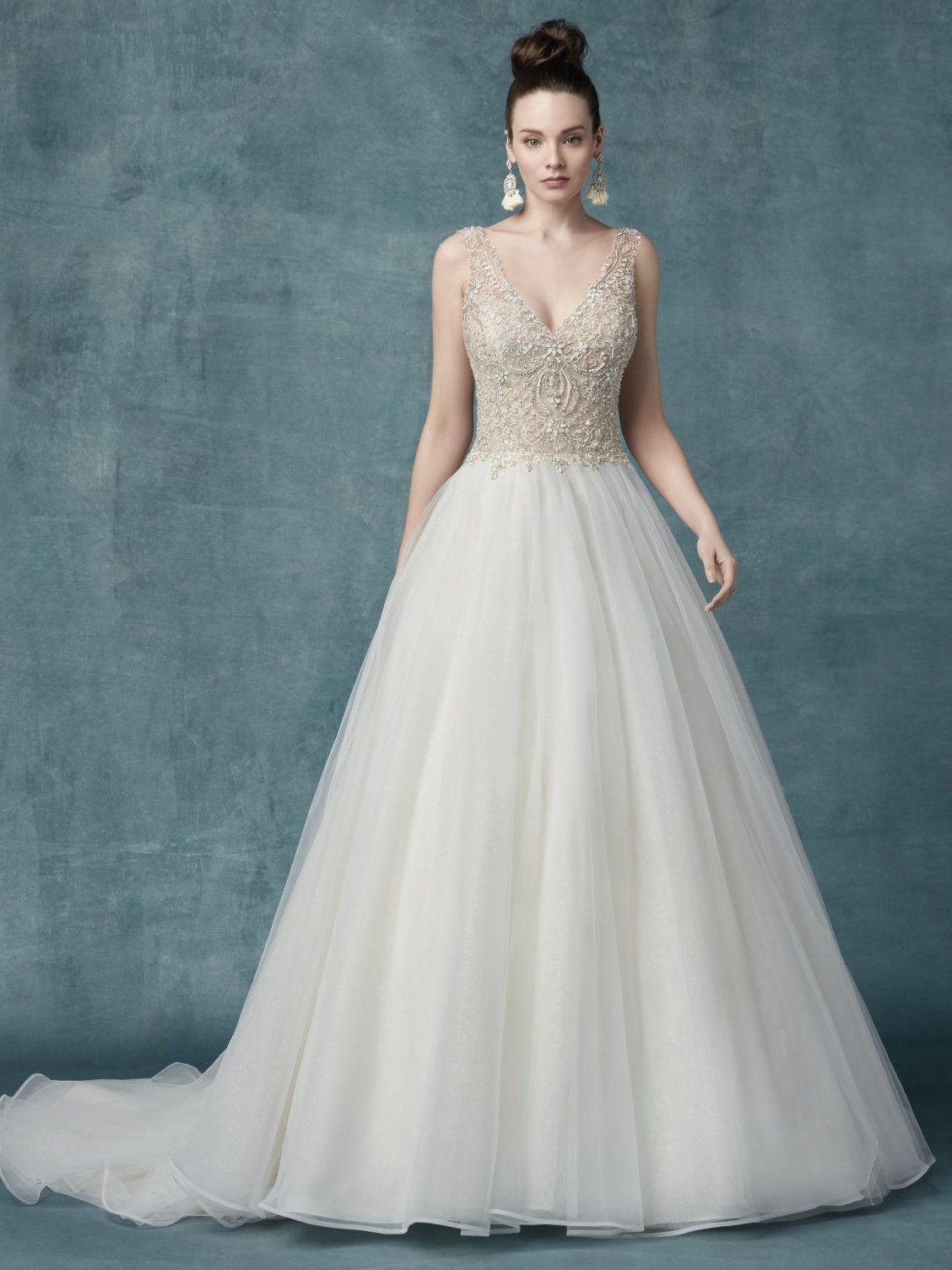 9f57701f0c  SophroniaMarie Glamorous princess wedding dress features a sheer bodice  accented in vintage-inspired beading and Swarovski crystals!  maggiesottero  ...