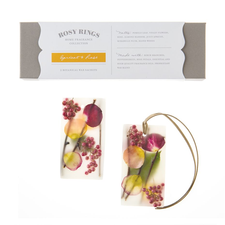 Rosy Rings Apricot & Rose Botanical Wax Sachets  - Pretty, fresh and flirty Apricot & Rose is a big, dewy pastel bouquet of pink roses & almond blossoms sweetened by juicy apricots and mirabelle plums. Pomelo leaf, violets and blond woods round out this undeniably charming scent.